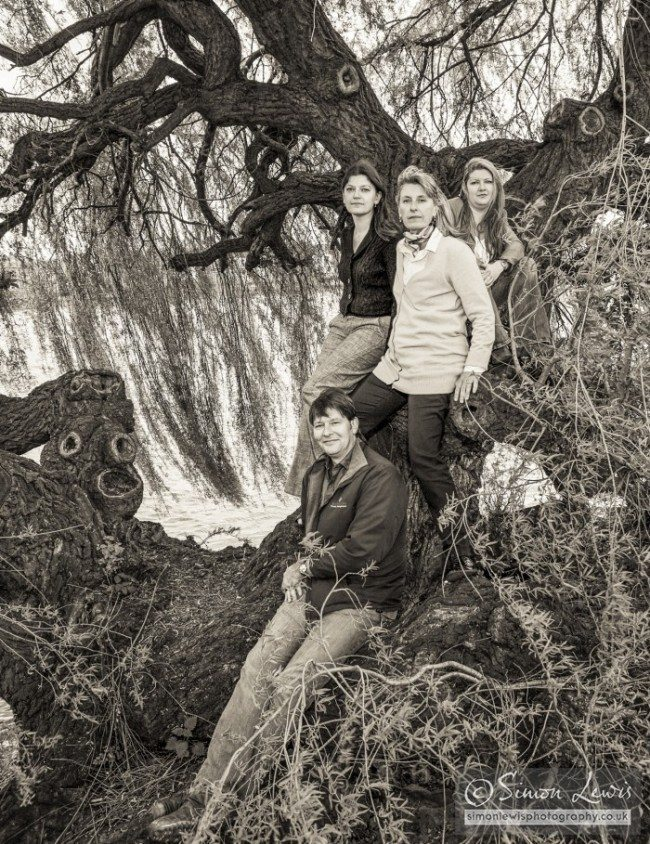 Portrait photograph of brother sisters in tree