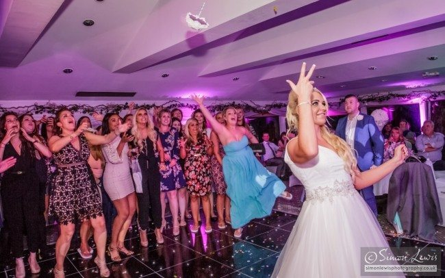 Bride-in-white-wedding-dress-throwing-Bouquet