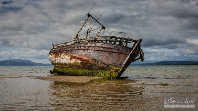 beached rotten wooden wreck of fishing boat Isle of Bute