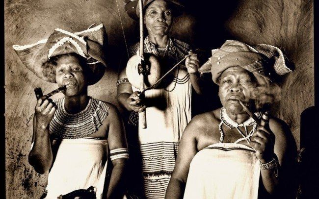 trio from women ensamble smoking traditional pipes